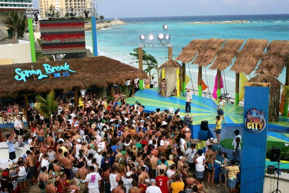 A crowd gathers in front of the stage during a taping for MTV Spring Break on the beach at The City nightclub March 8, 2005 in Cancun, Mexico. (Photo: Scott Gries/Getty Images)
